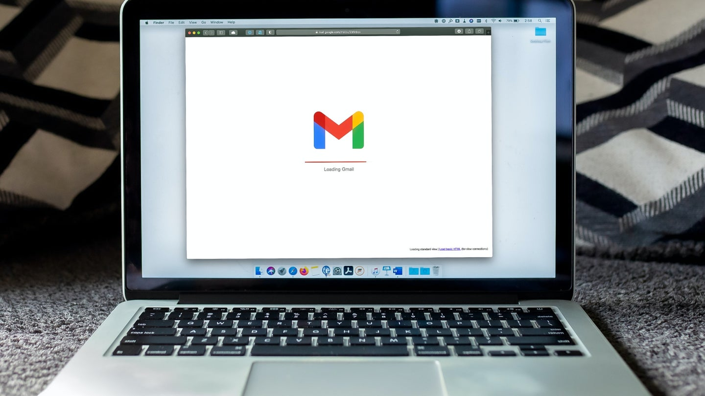 A laptop with Gmail loading in a browser.