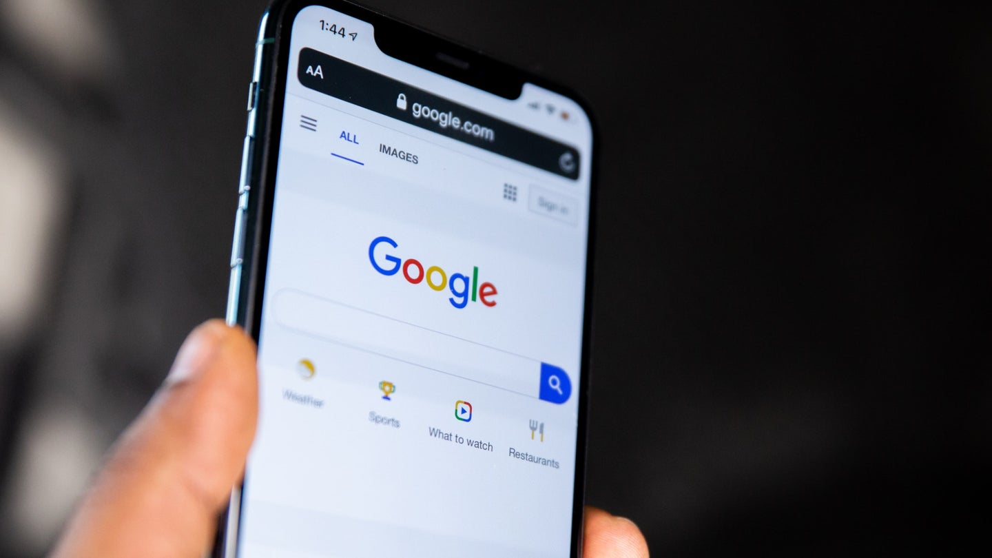 A phone with a Google account open on the screen.