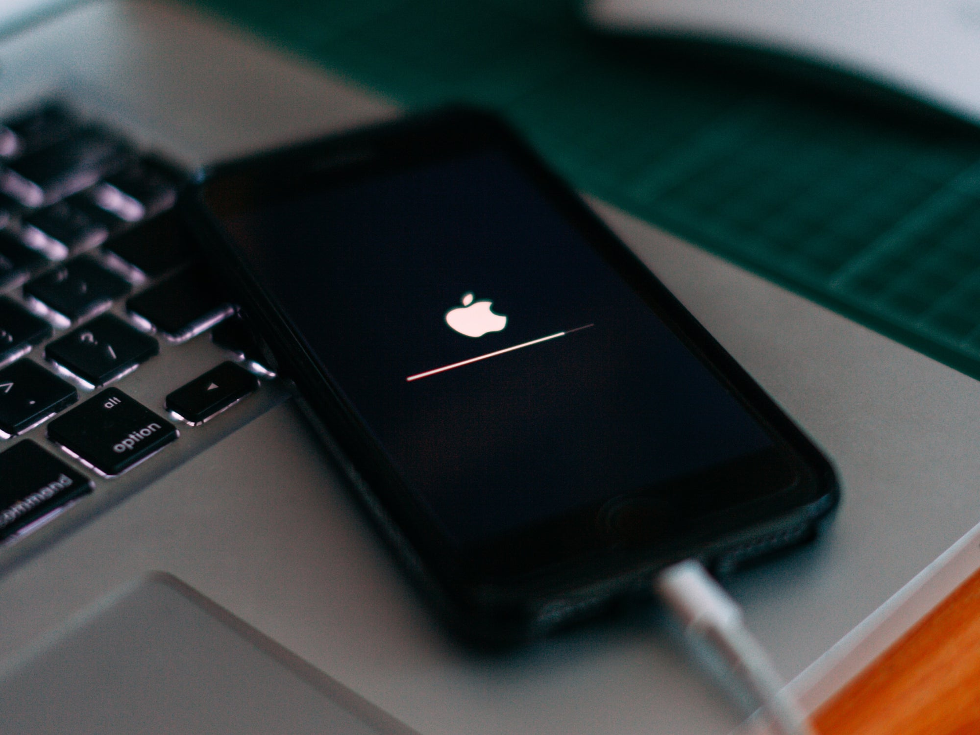 An iPhone plugged in and updating its software.