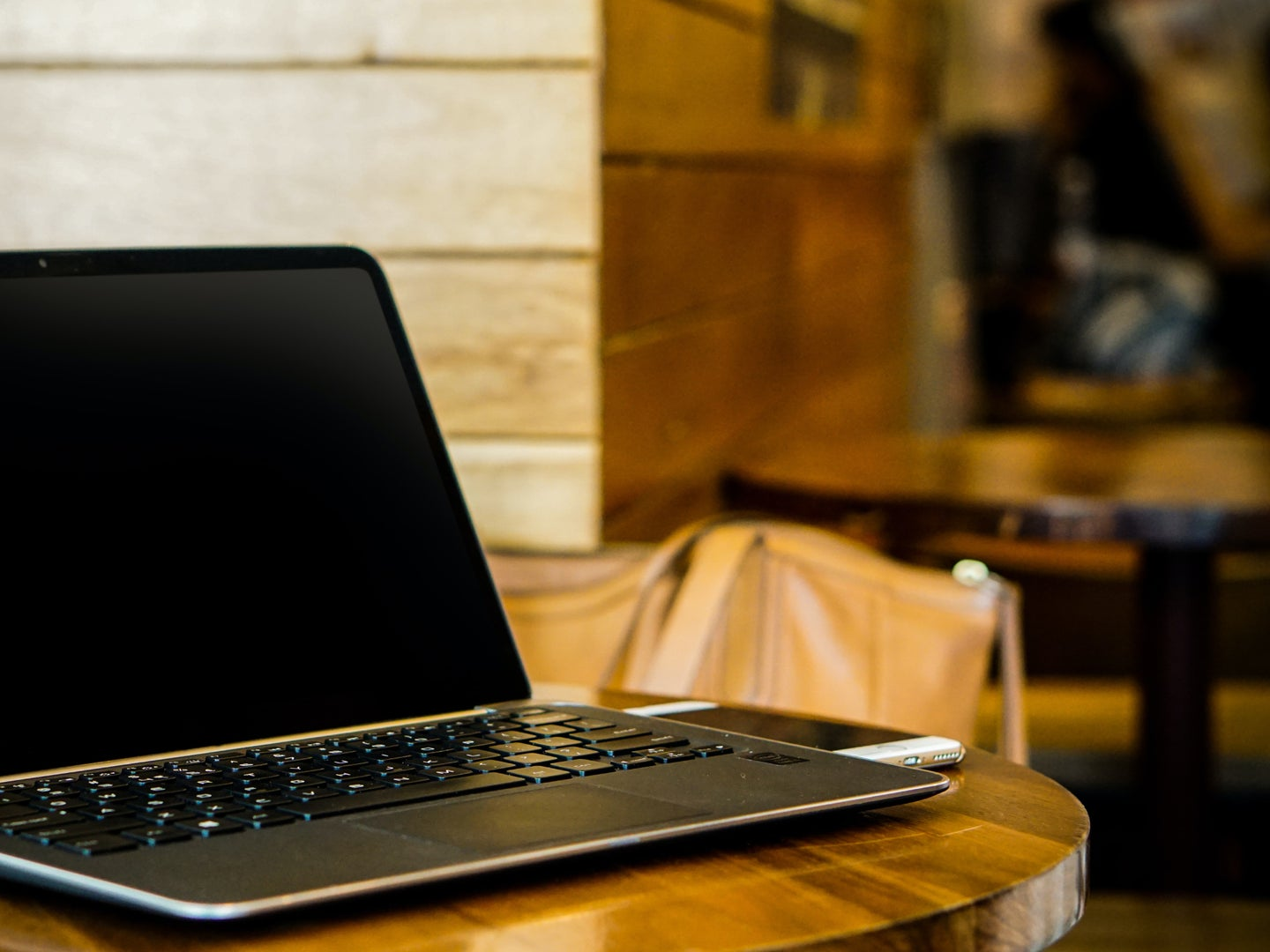 An unattended laptop at a coffee shop.