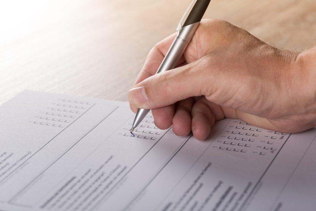 a person marks a ballot
