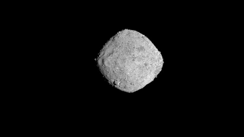 Asteroid Bennu floating in black space.