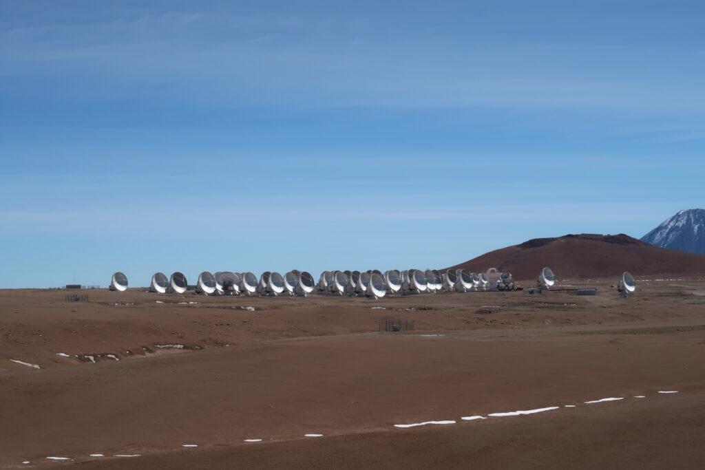 Dozens of dishes dot the desert horizon