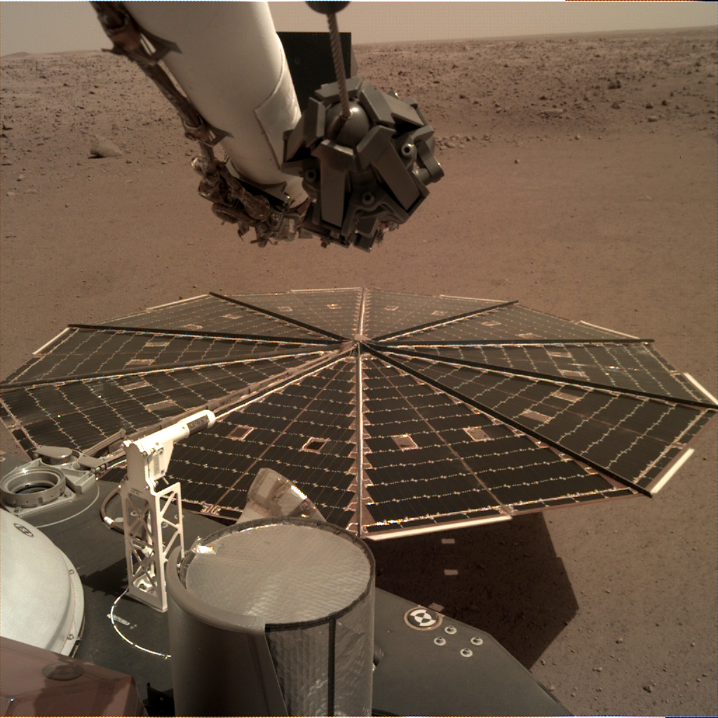 InSight's solar panel sits in front of a Martian landscape