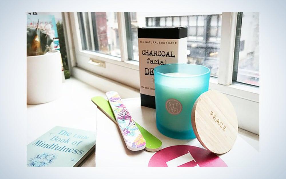 A candle, nail files, and facial mask