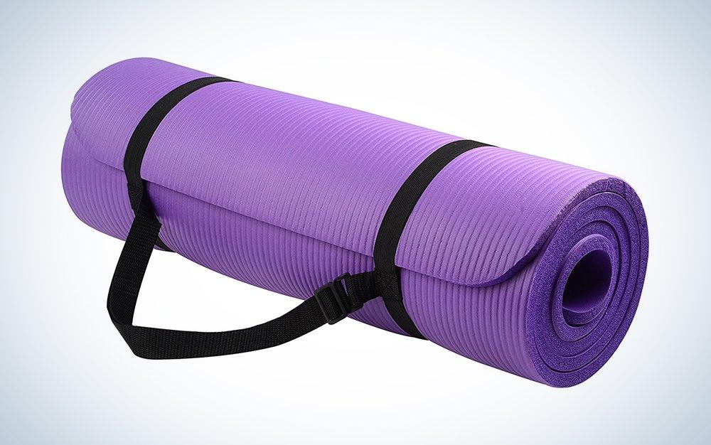 rolled up purple yoga mat