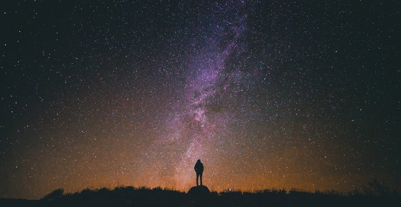 A person looks up at the Milky Way