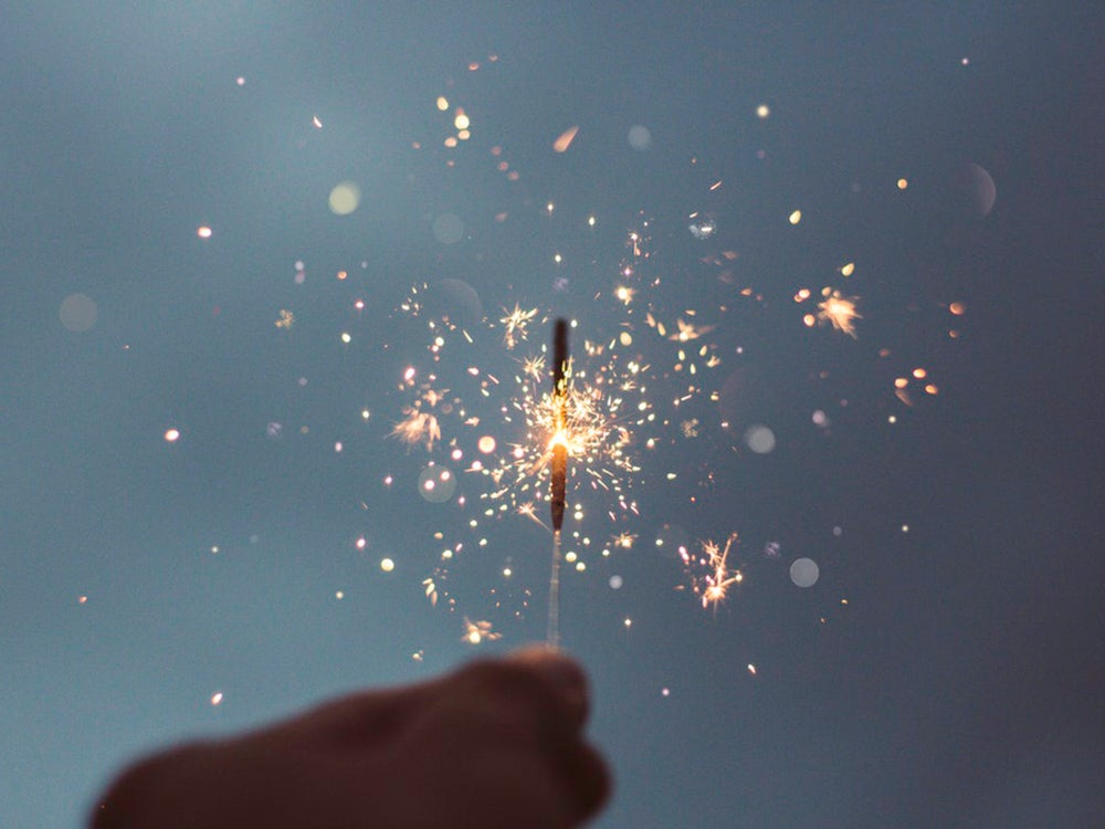 sparkler against evening sky