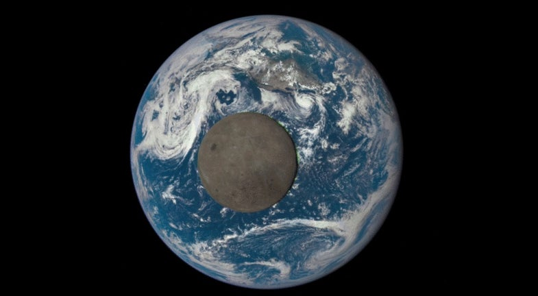 the moon crossing in front of the earth