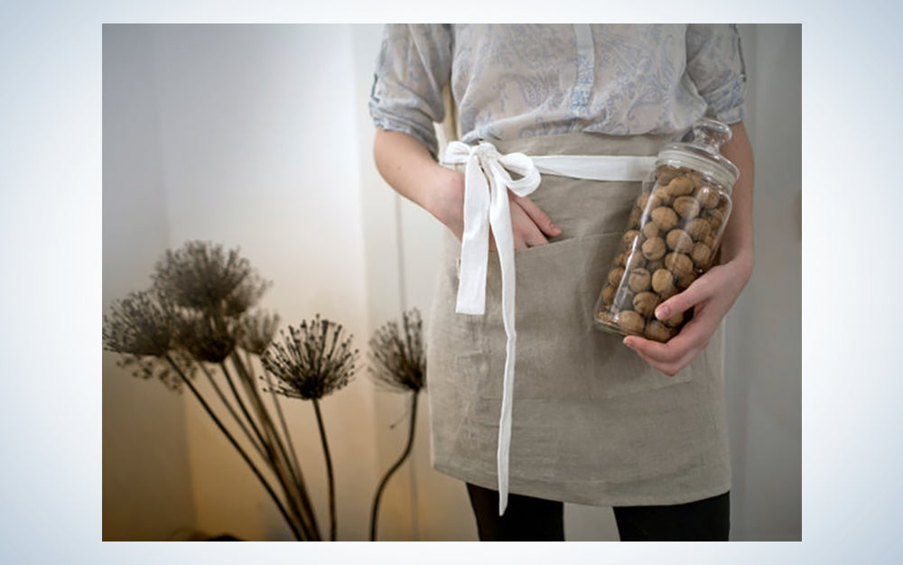 someone wearing a linen apron