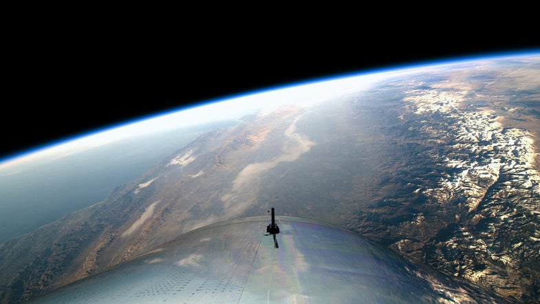 earth is visible from the window of a rocket in space