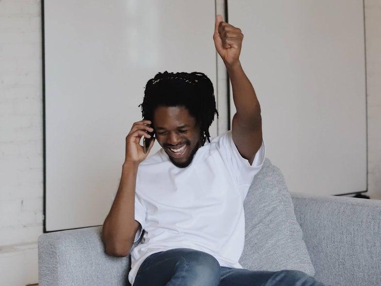 man celebrating on the phone
