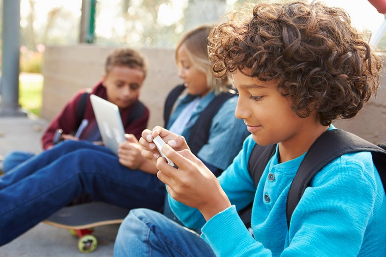 Kids playing on phones and computers gaming ads