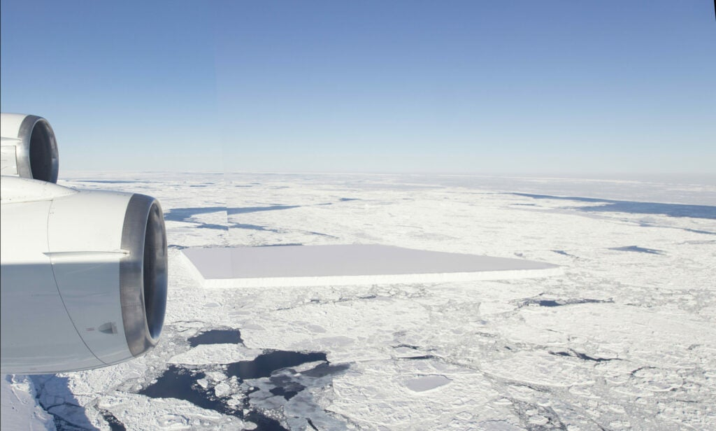 a plane flies over a rectangular iceberg