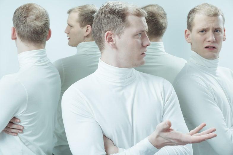 five identical men in white turtlenecks look confused