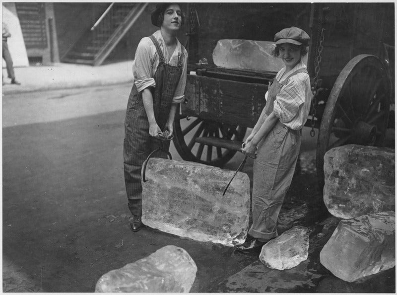 two women holding a block of ice