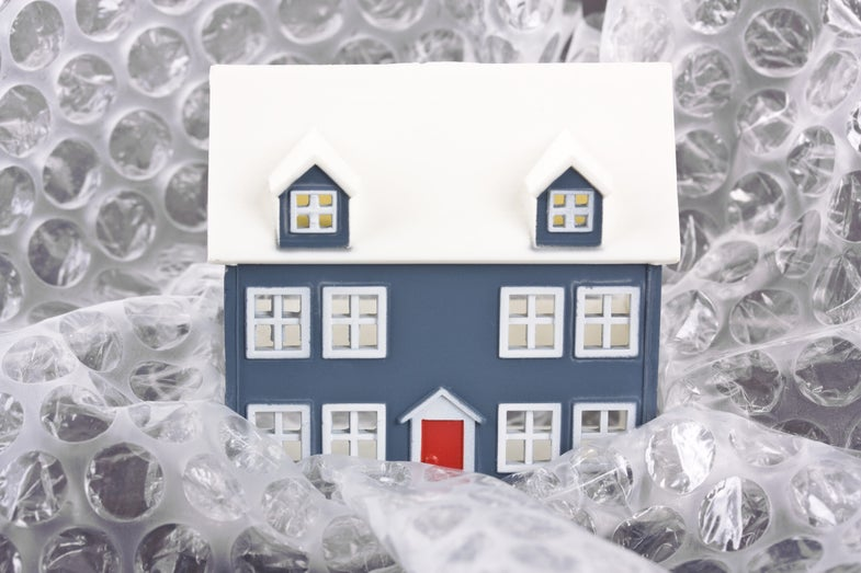 a tiny house wrapped in bubble wrap