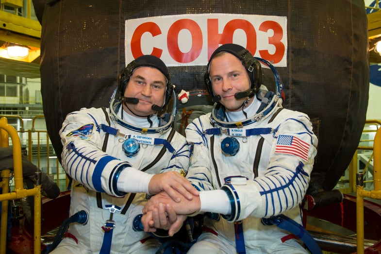 two astronauts posing together