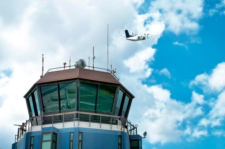 Air traffic control tower plane takeoff