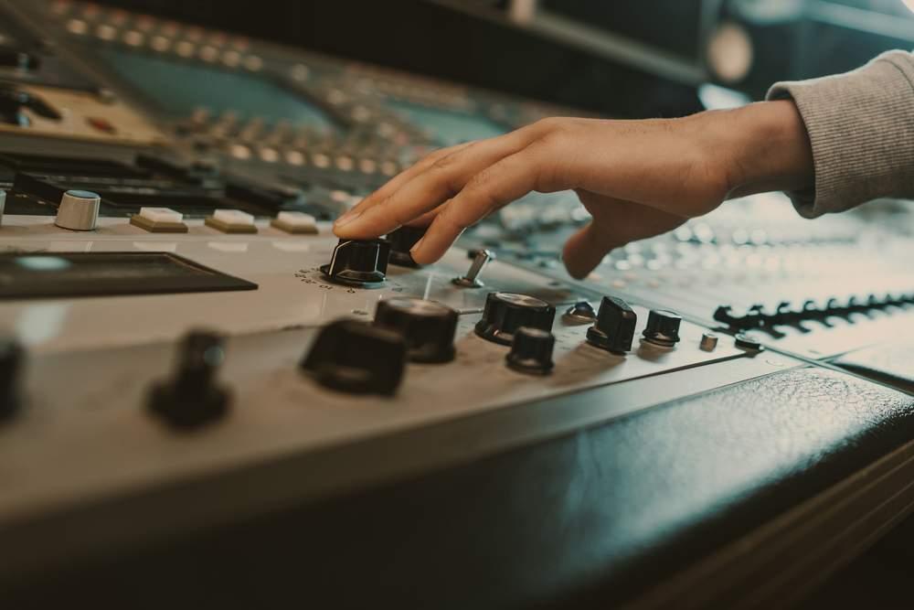 hand touching sound board
