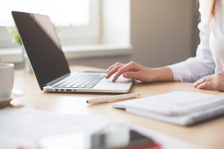 Women typing on laptop