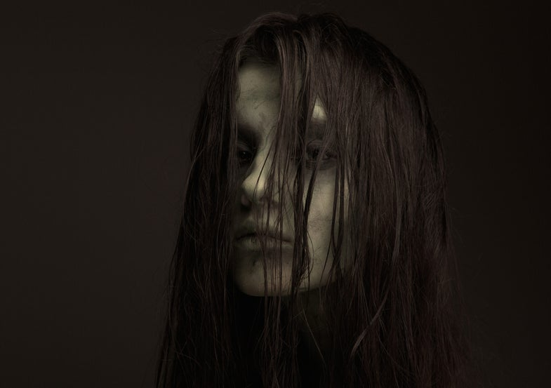 a woman in corpse makeup