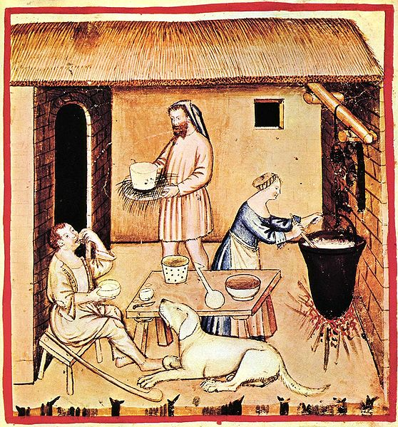 a medieval illustration of people cooking