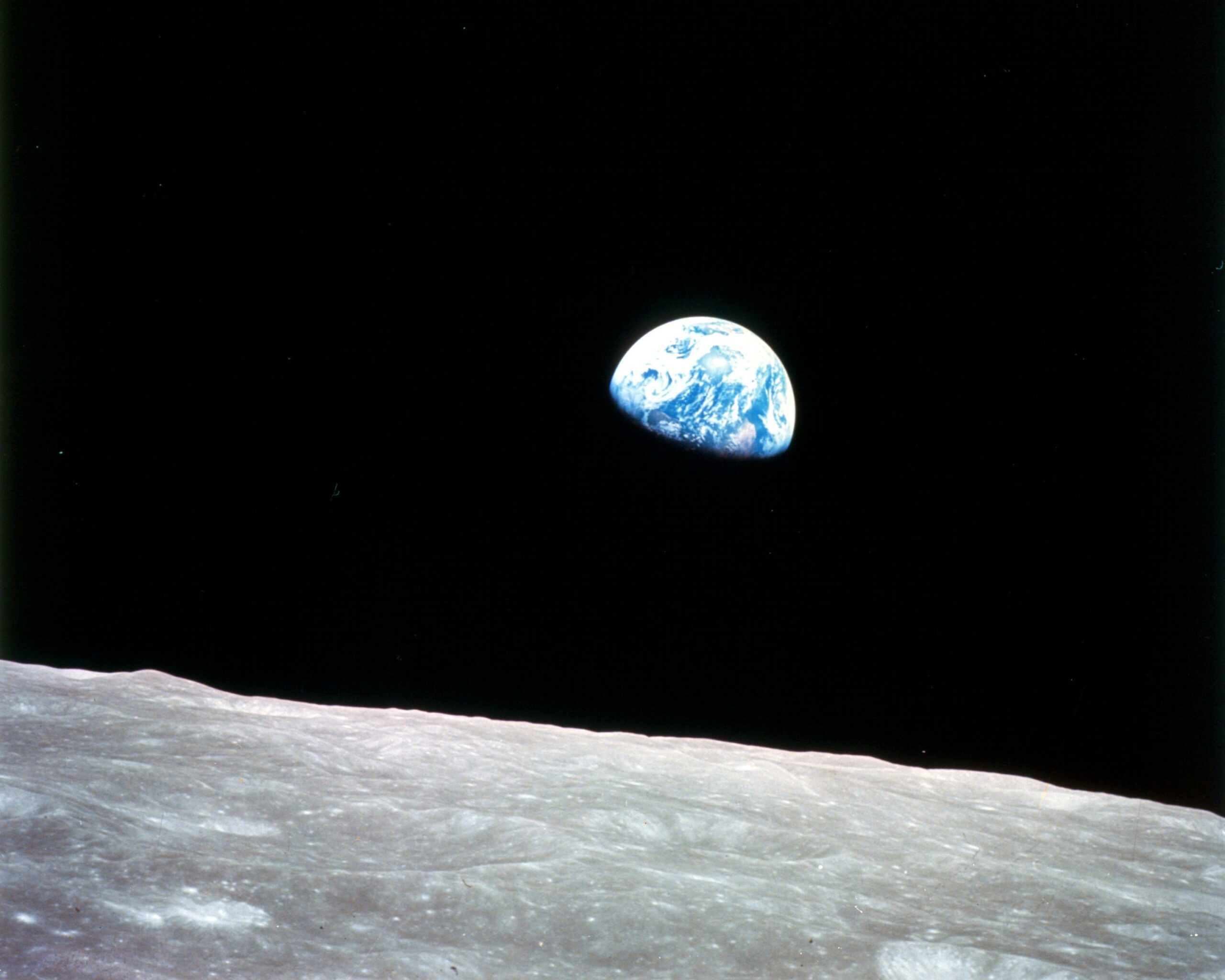 the earth rising over the moon