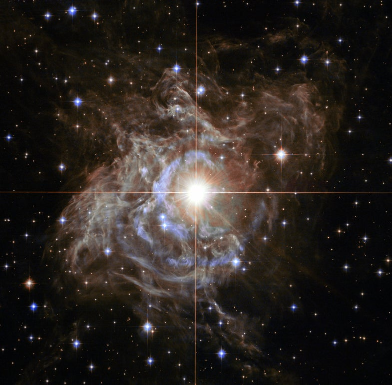 a nebula in space with a bright star in the center