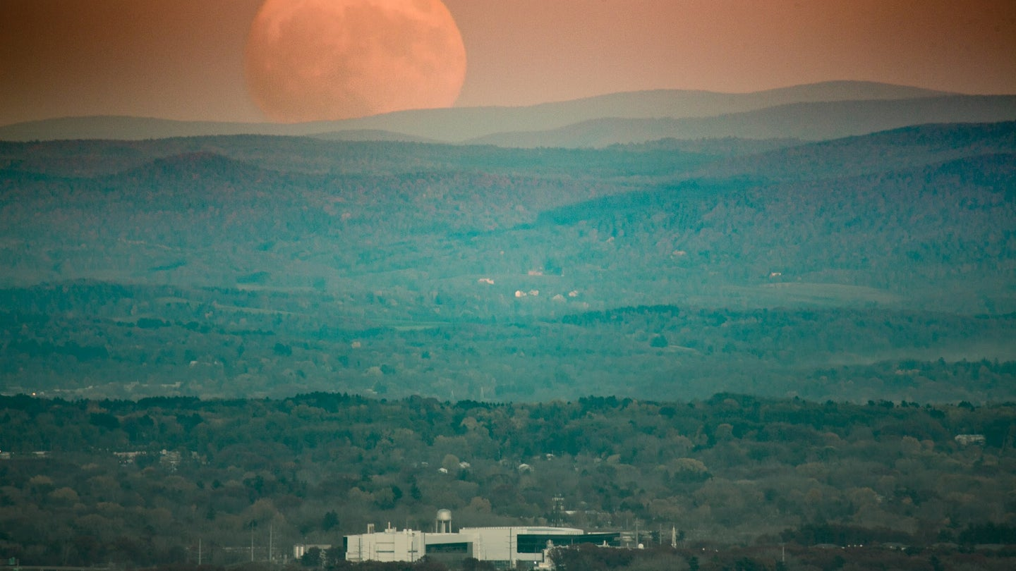 Super Moon rise over a valley