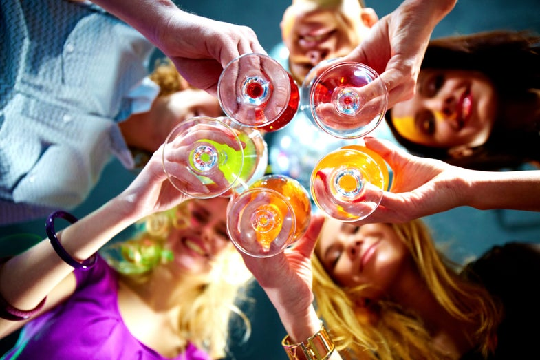 a group of people toasting wine glasses