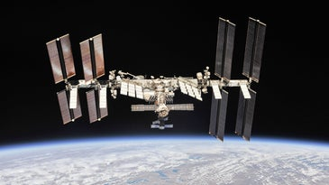 the international space station floats over earth