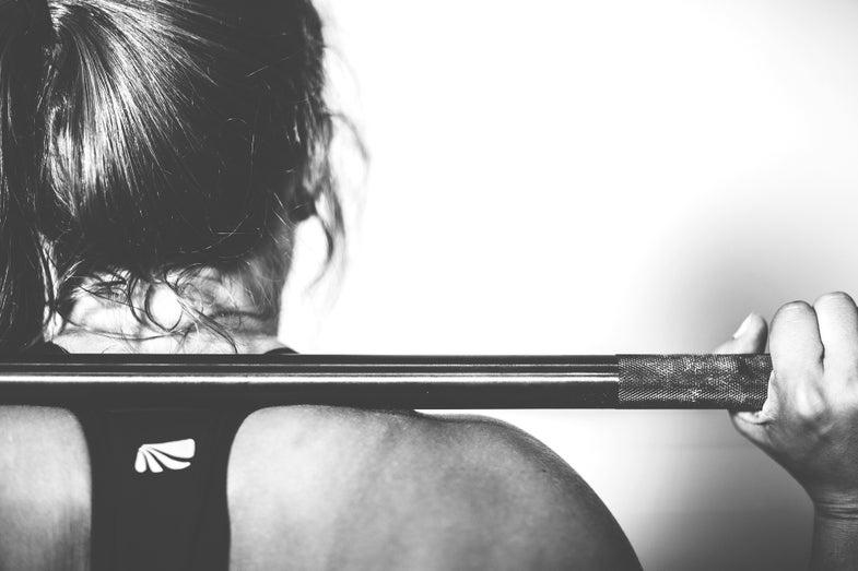 woman barbell lifting