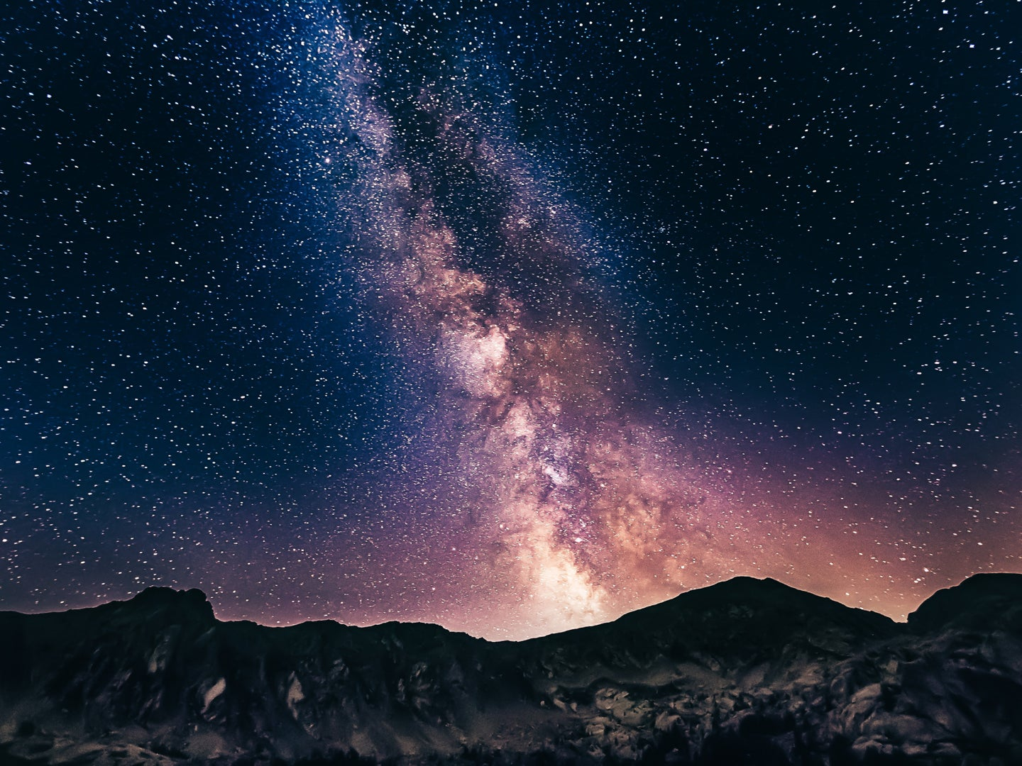 The Milky Way at night over mountains.