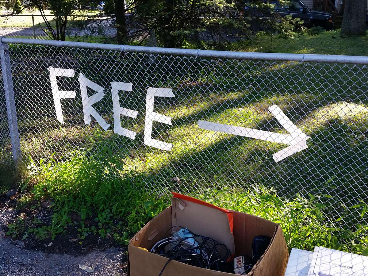 a sign made of tape that points to free stuff