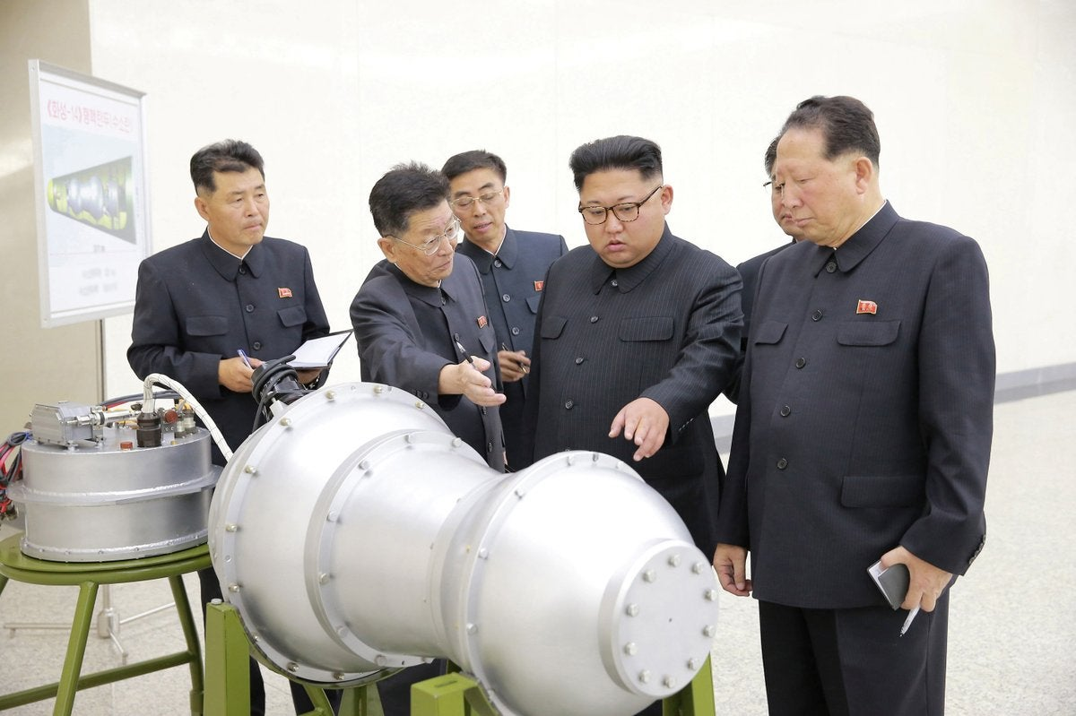 Kim Jong-un inspects what appears to be a thermonuclear warhead