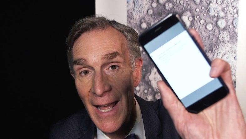 Bill Nye holding a phone