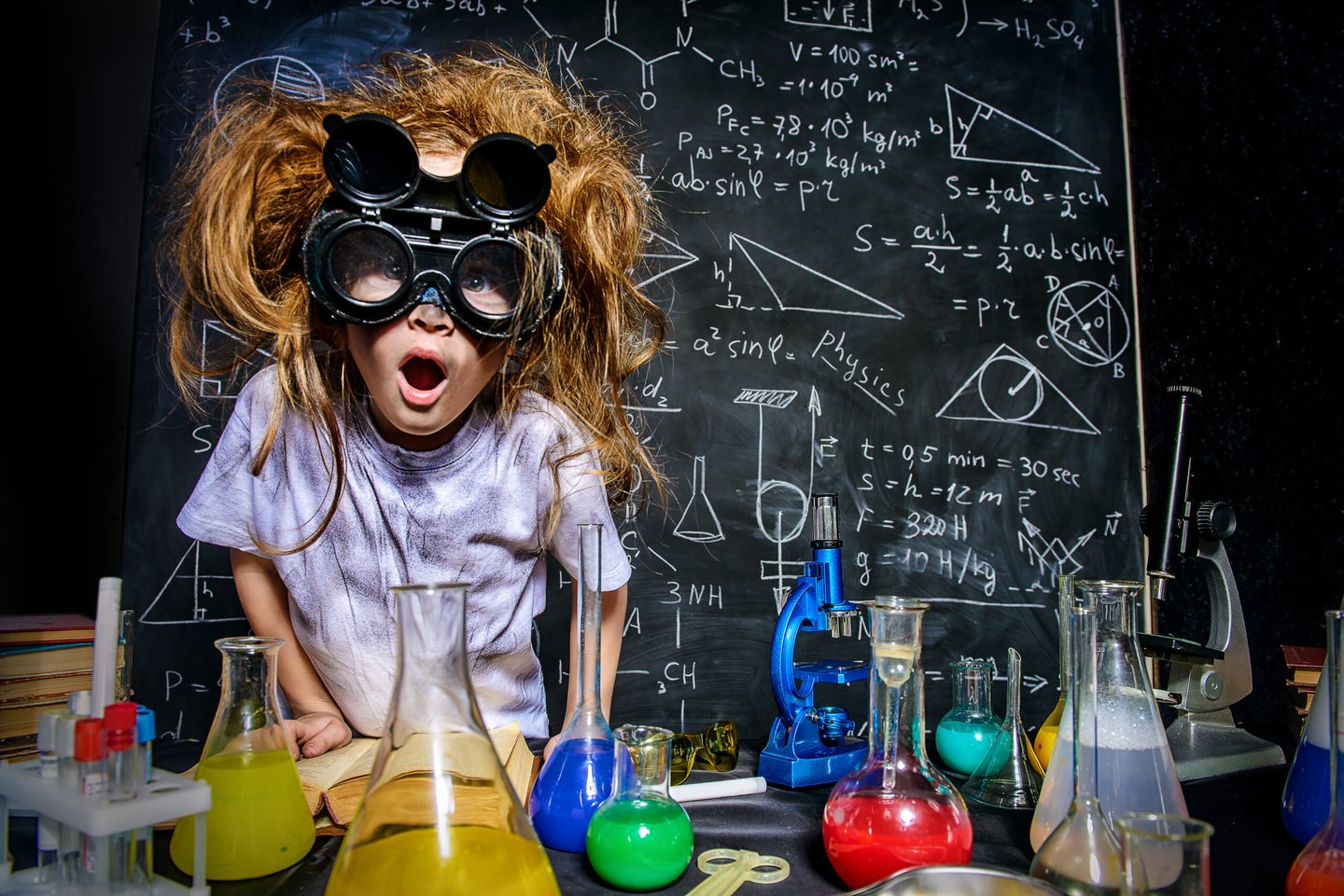 a kid playing with lab equipment