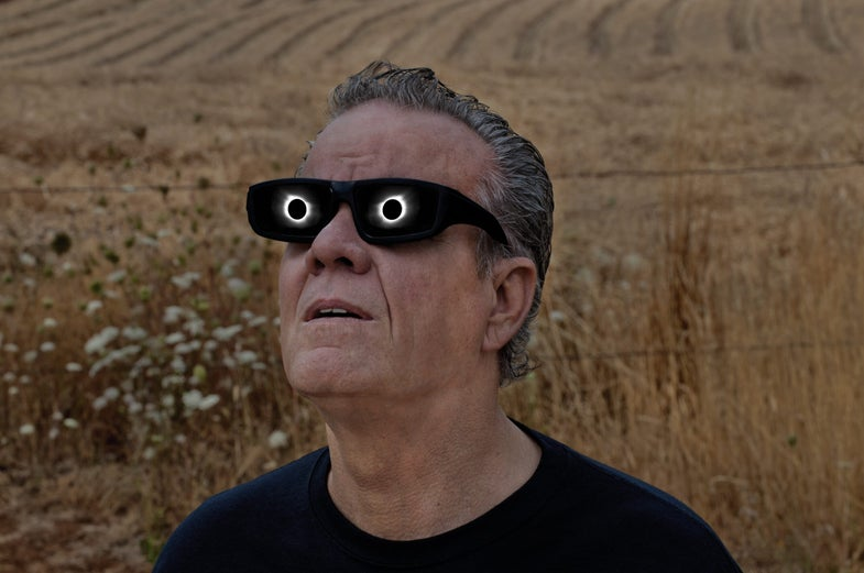 man watching eclipse