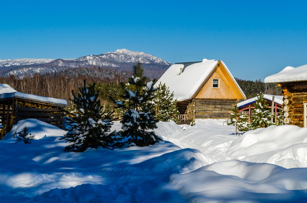 cabin covered in snow