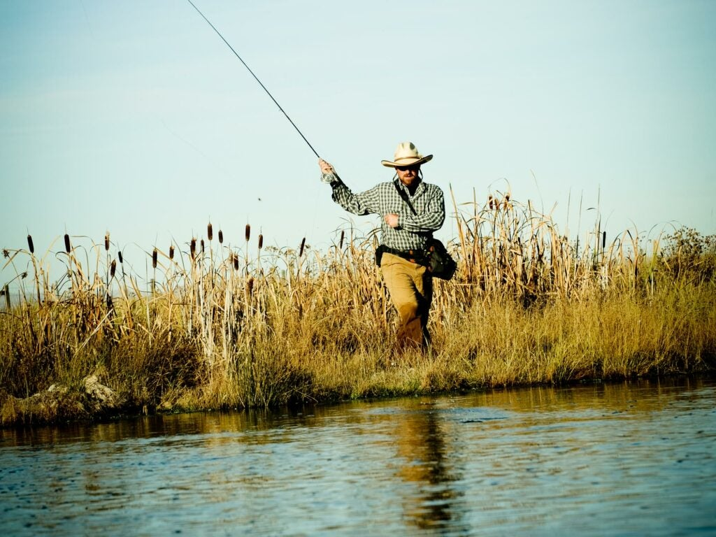 fisherman casting trout fishing madison river