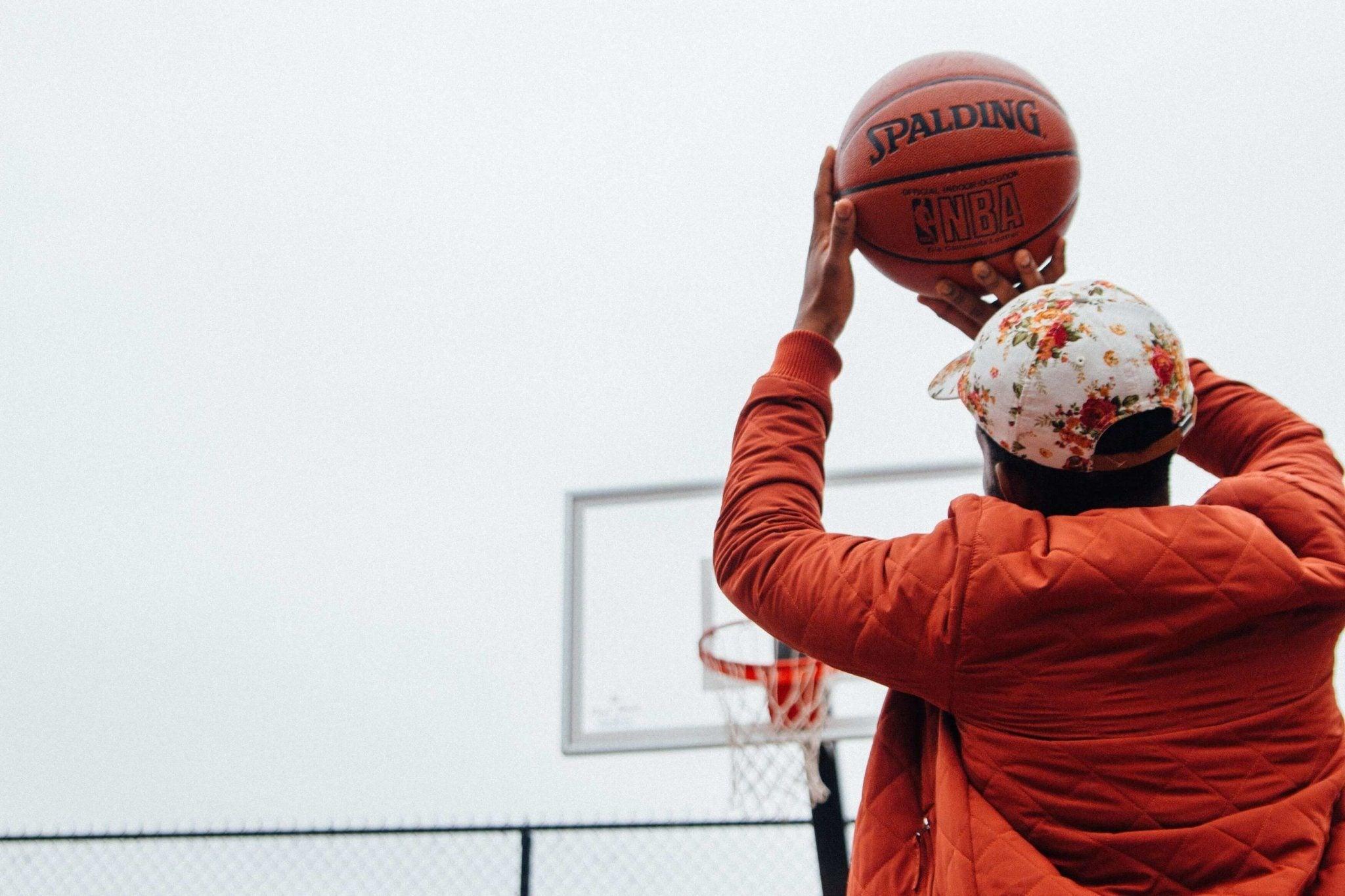 man taking basketball shot