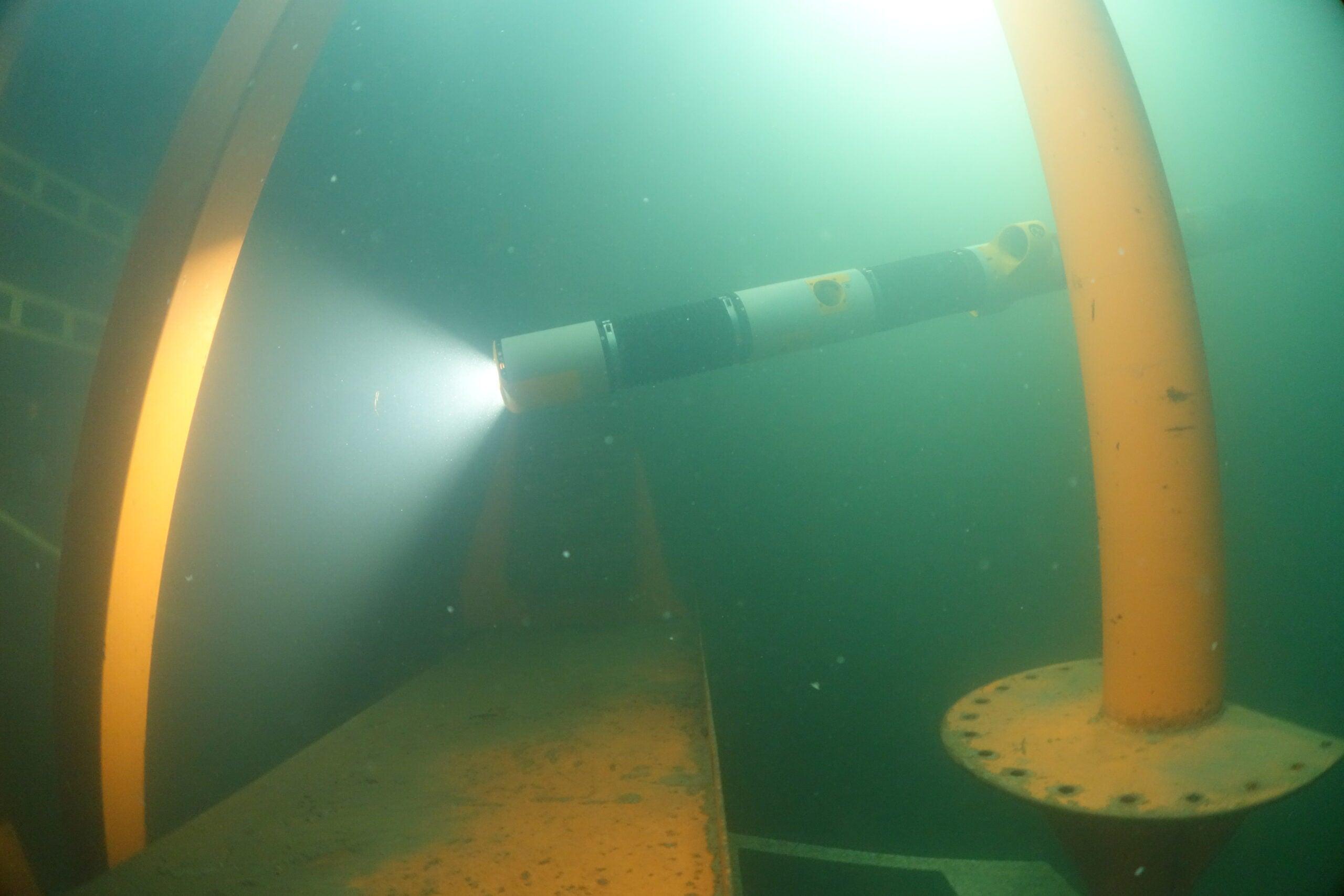 Eelume robot explores a test rig