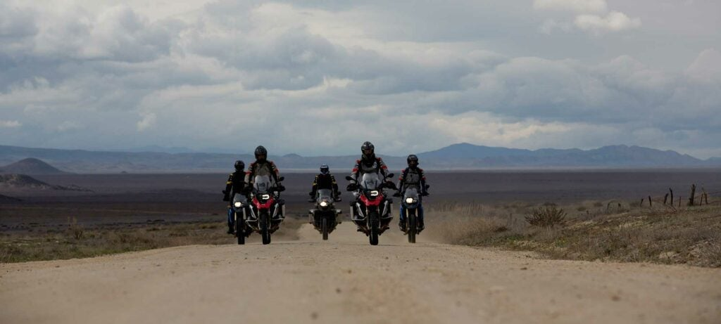 motorcyclists on a dirt road