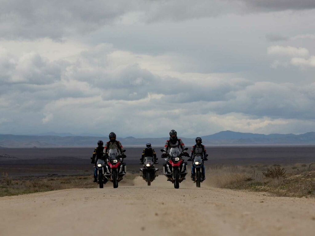 group of motorcycles on dirt road