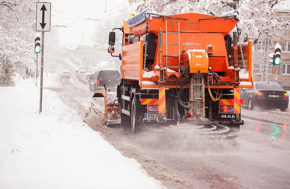 Snow plow Spraying salt onto roads