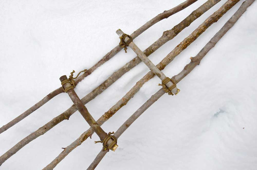 cross pieces of sticks lashed together