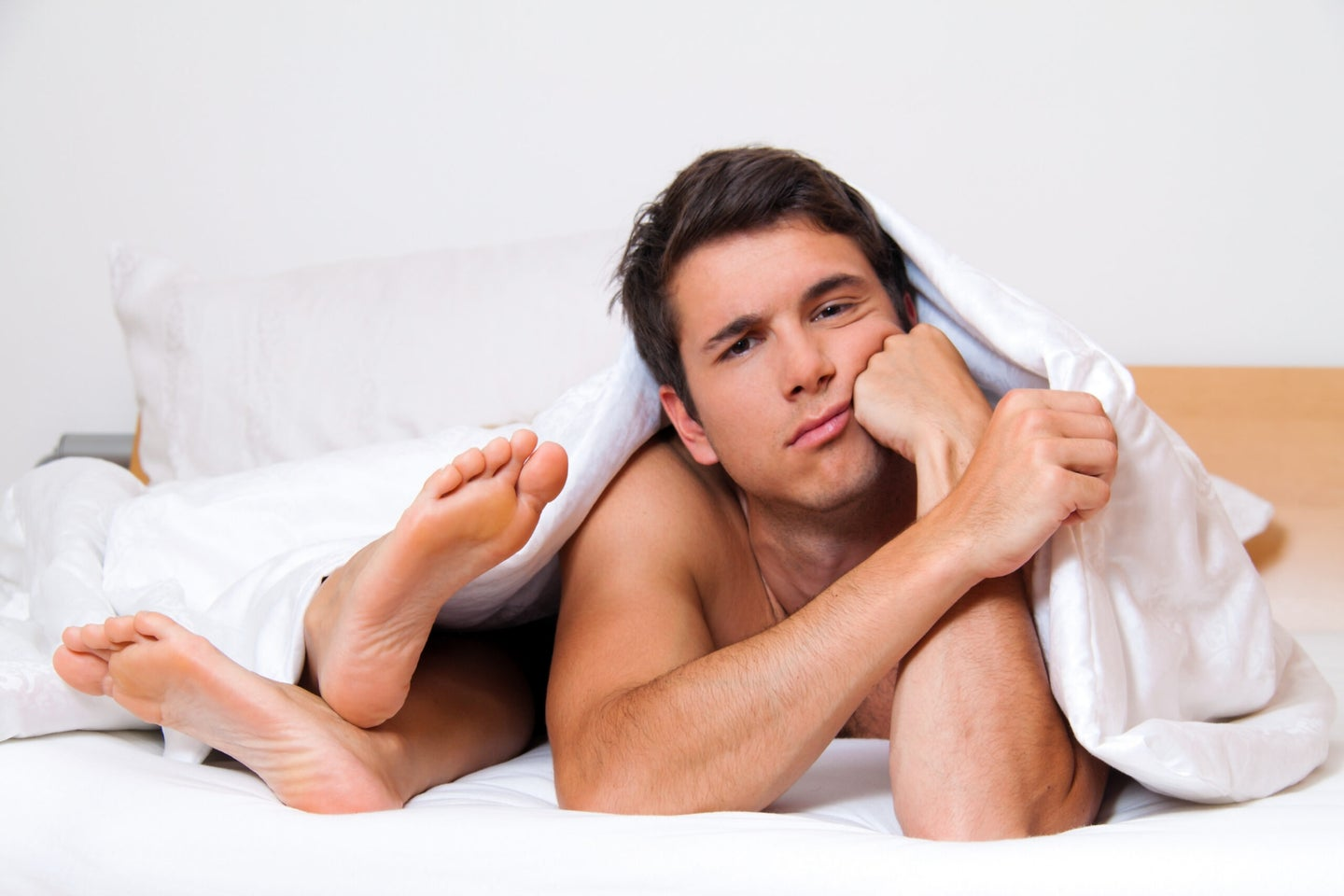 confused man in bed