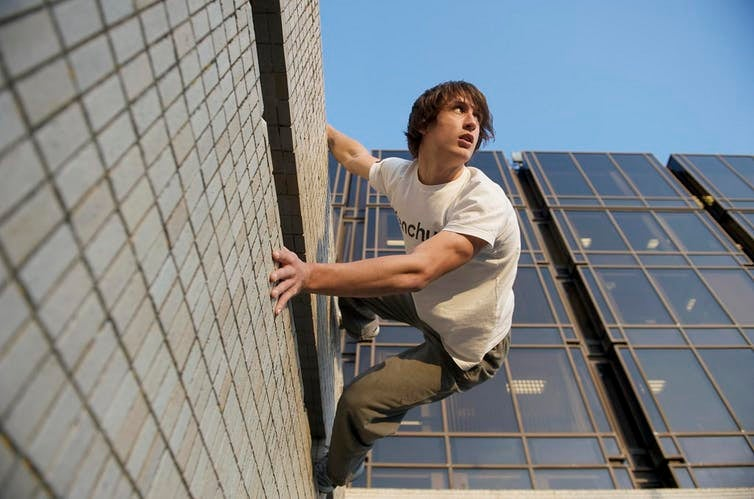 man against the wall parkour