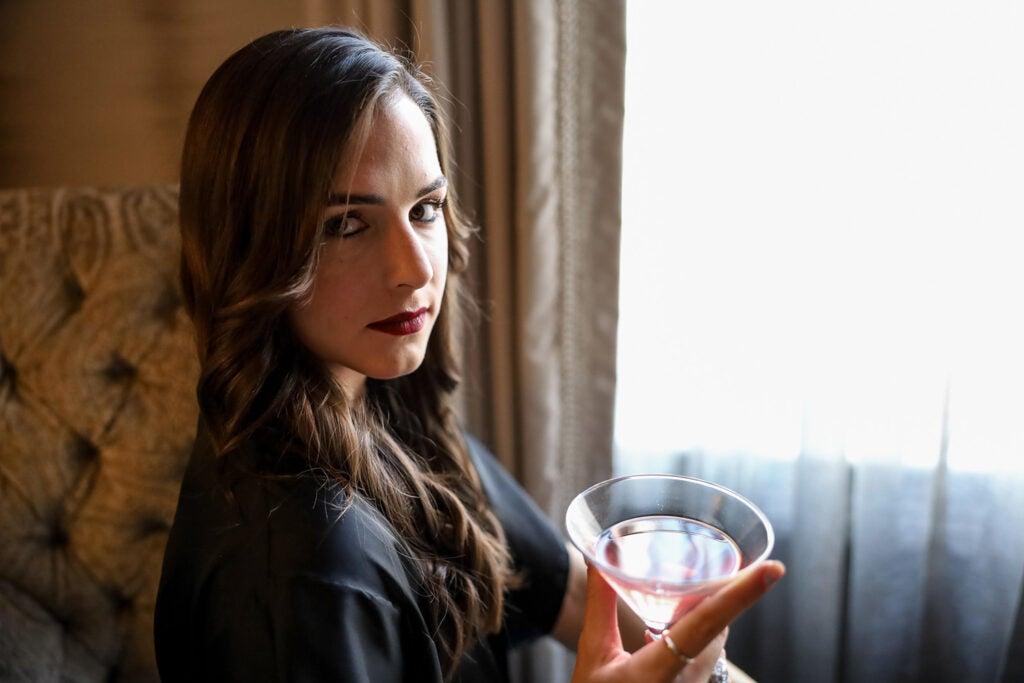 woman holding martini glass